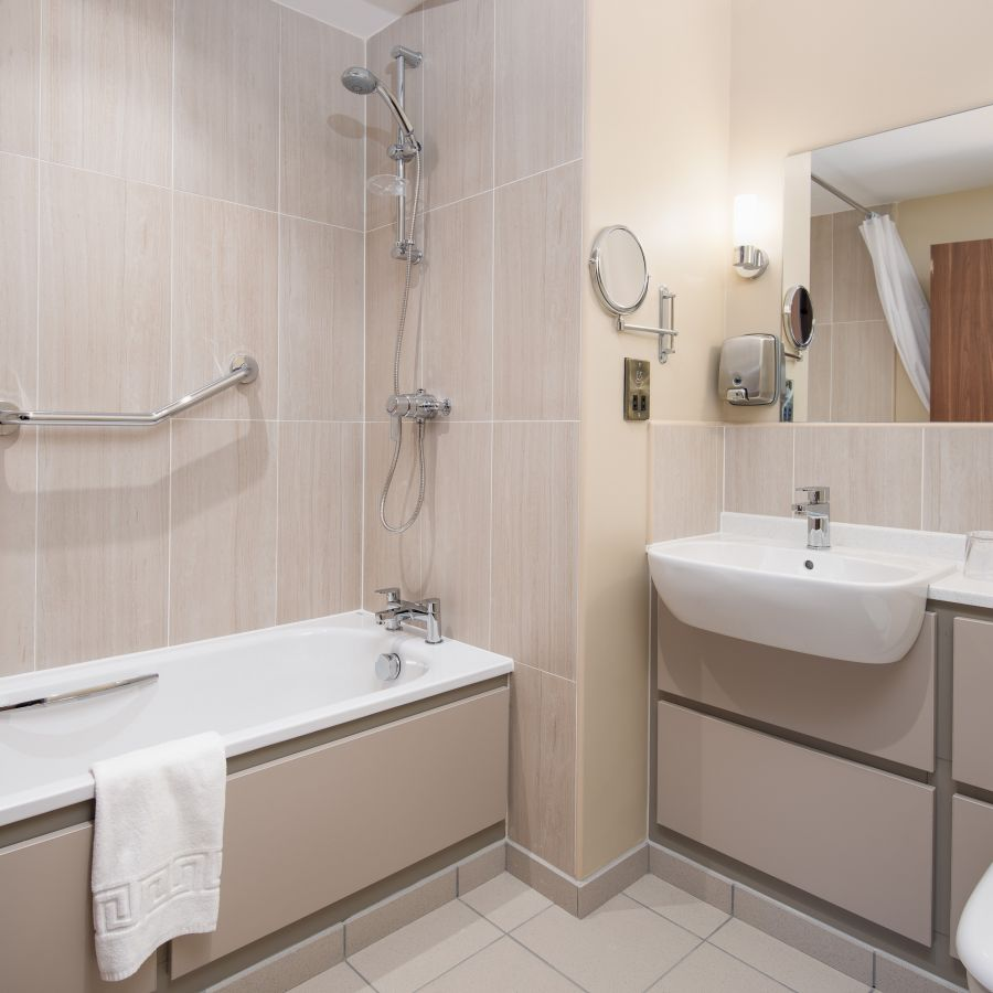 Bath or shower option in rooms