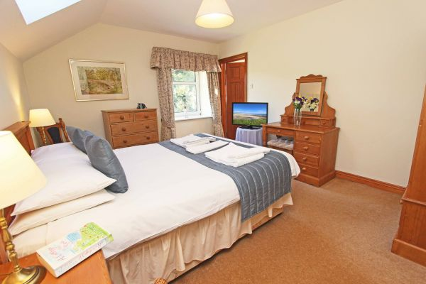 The Mill House, master bedroom with ensuite