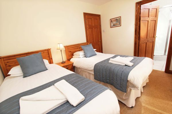 The Mill House, twin bedroom with ensuite shower room