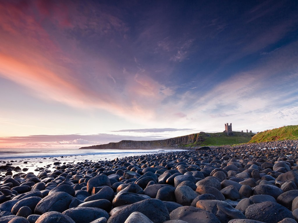 Embleton Bay and Dunstanburgh Castle at sunrise credit Coastal Retreats